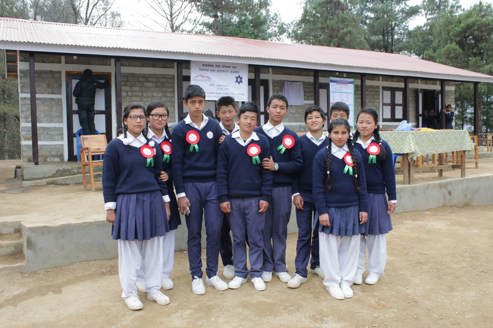 Students posing infront of Newly rebuilld School